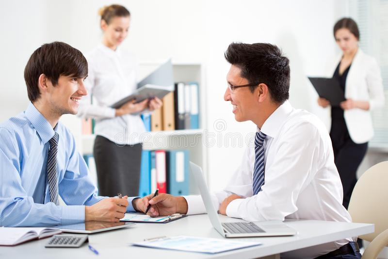 Business people having meeting in an office stock photography