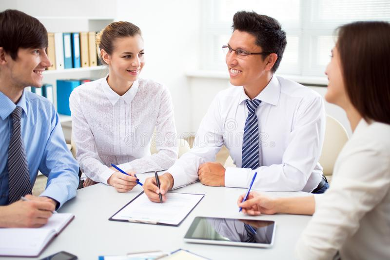 Business people having meeting in an office royalty free stock photo