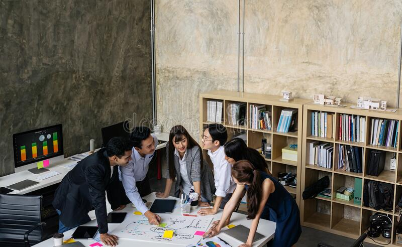 Business people are working meeting at creative office workplace.Happy group of Asian creative team Brainstorming. royalty free stock photography