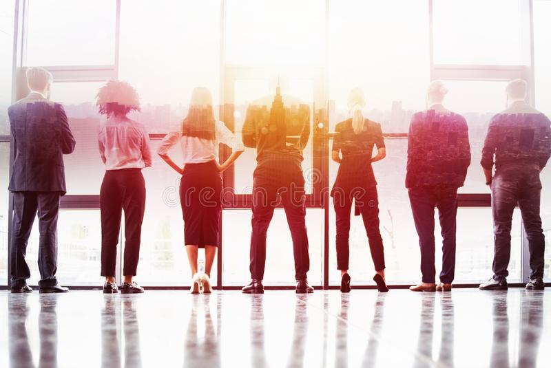 Concept background with business people silhouette looking out of the window in a modern office. Double exposure stock images