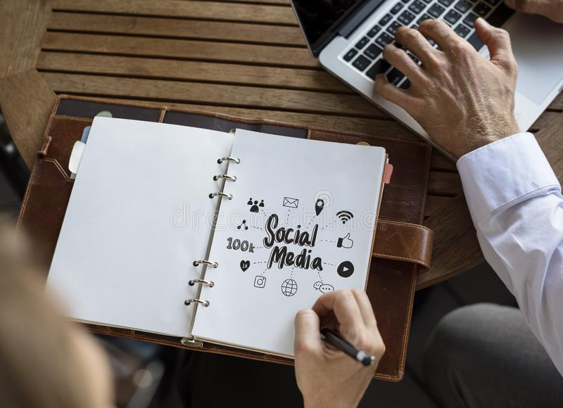 Business people working on a social media plan stock photo