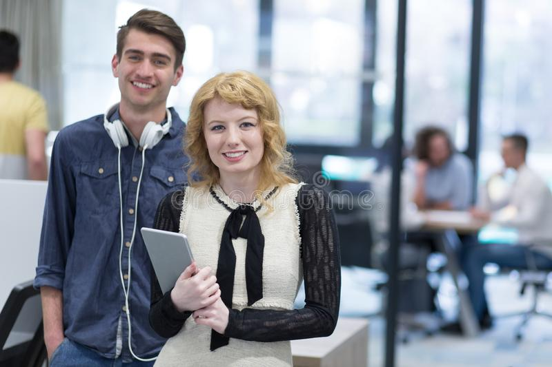 Business people working with tablet in startup office stock photography