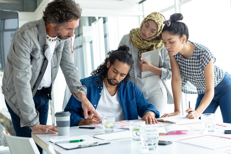 Business people working together at conference room in a modern office. Front view of diverse business people working together at conference room in a modern royalty free stock photos