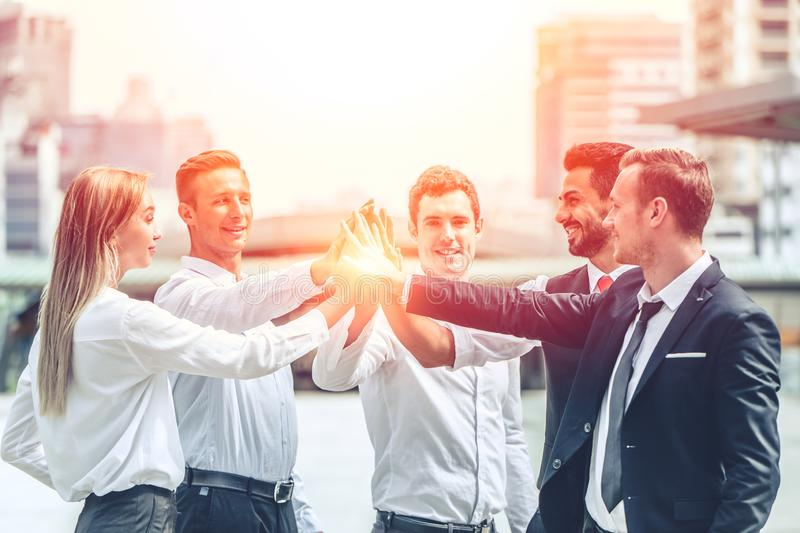 Business people working together join hand for good teamwork for company stock images