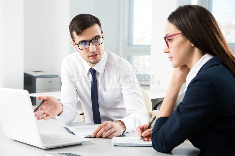 Business people working together in the office stock images