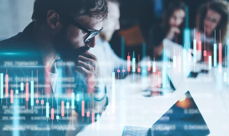 Business people working together at night office.Technical price graph and indicator, red and green candlestick chart royalty free stock photo