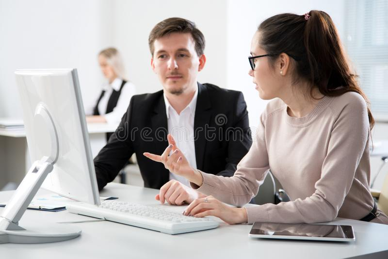Business people working together in the office stock image