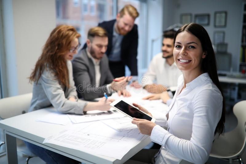 Business people working together on project and brainstorming stock image