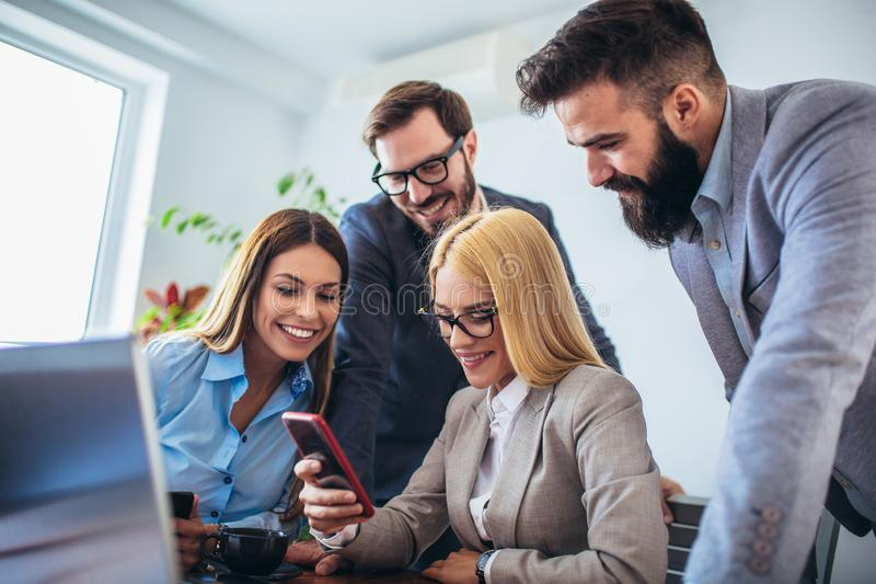 Business people working on project and brainstorming in office using smart phone royalty free stock photos