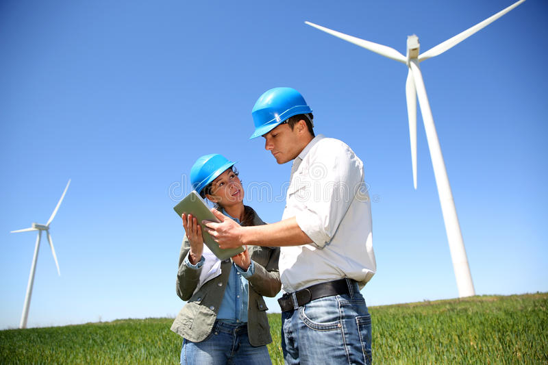 Business people working in turbine field royalty free stock photos
