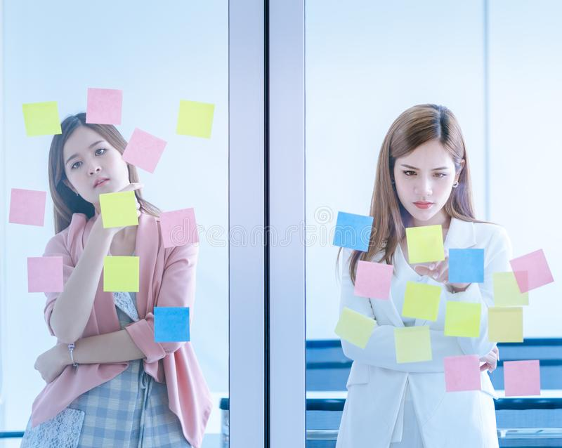 Business people writing idea on to note paper for planning. Business people is writing idea on to note paper for planning royalty free stock image