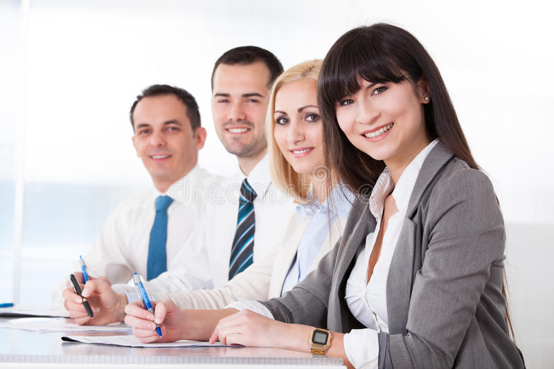 Business people writing meeting notes stock photos