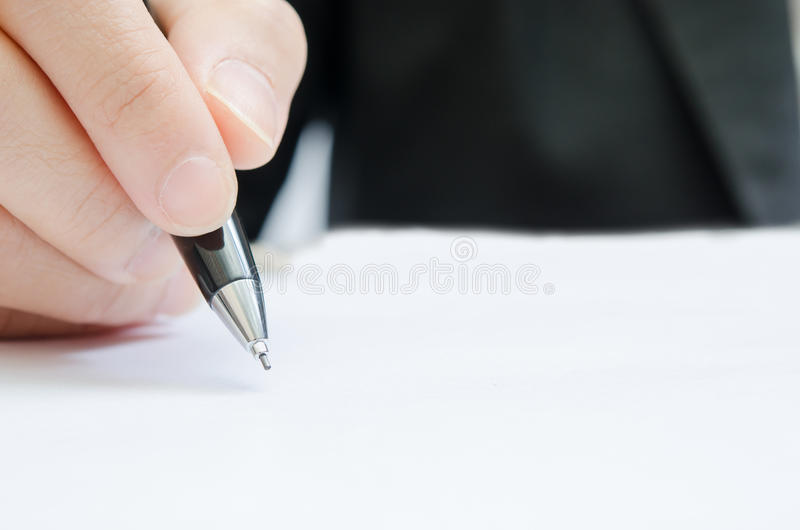 Business people writing the pen. On blank paper stock photo