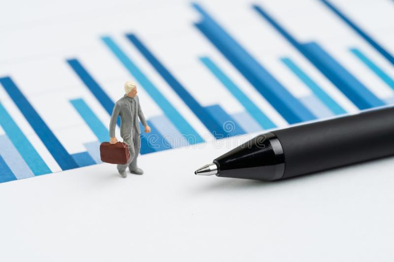 Business performance, KPI, key performance indicator or company revenue or profit on management, miniature people businessman royalty free stock photography