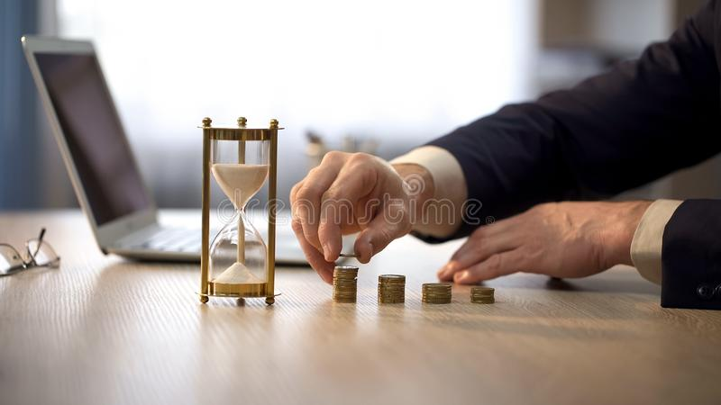 Business person adding coin to stack, investment in future, successful start-up. Stock photo stock photography