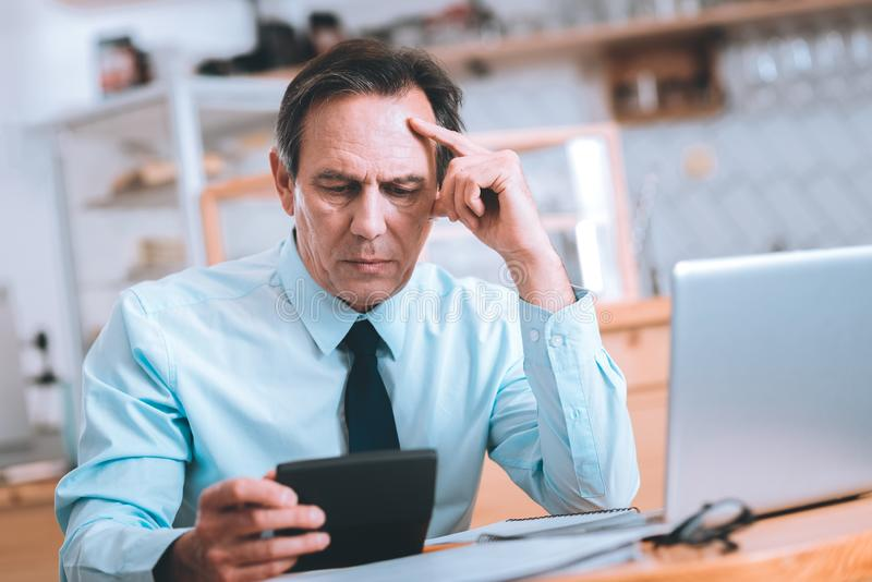 Serious businessman being deep in thoughts royalty free stock image