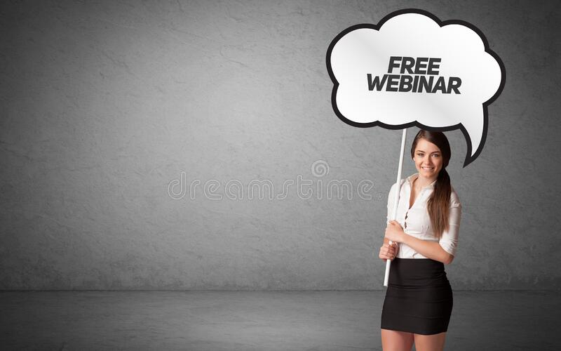 Business person in casual holding road sign royalty free stock photos