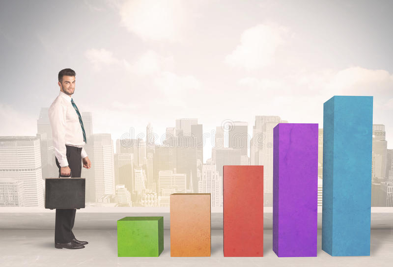 Business person climbing up on colourful chart pillars concept. On city background royalty free stock image