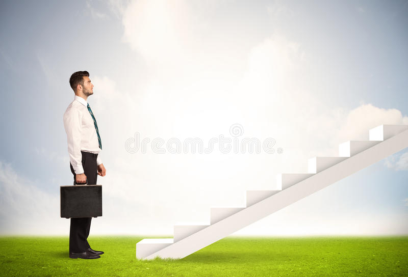 Business person climbing up on white staircase in nature. Background concept stock image