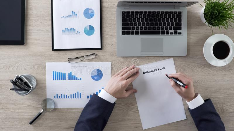 Business person considering items to business plan, lack of ideas, top view. Stock photo royalty free stock images