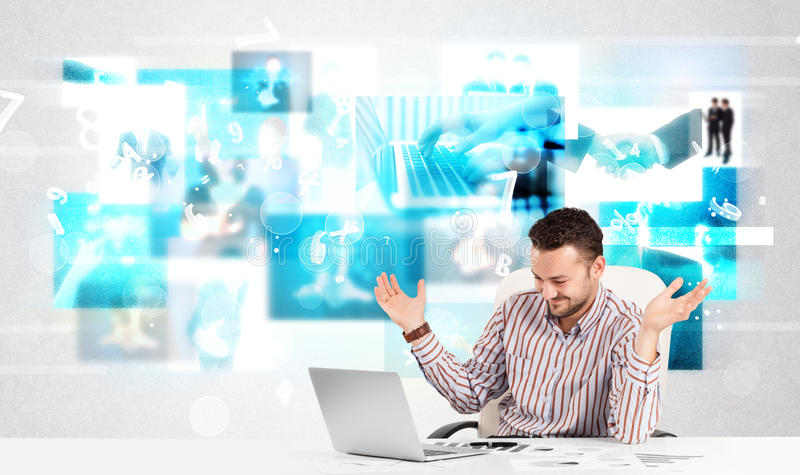 Business person at desk with modern tech images at background stock images