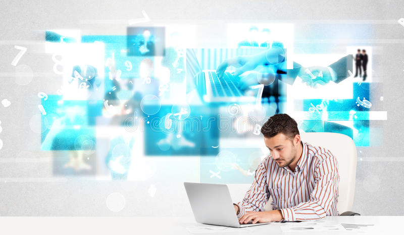 Business person at desk with modern tech images at background royalty free stock photos