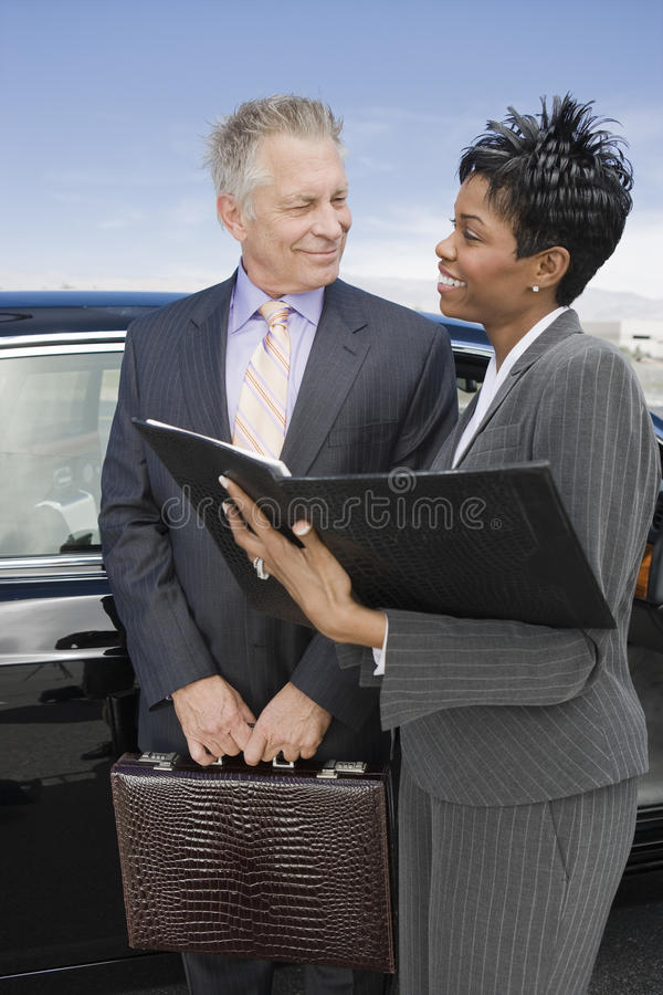 Business Person Discussing Reports At Airfield stock photo