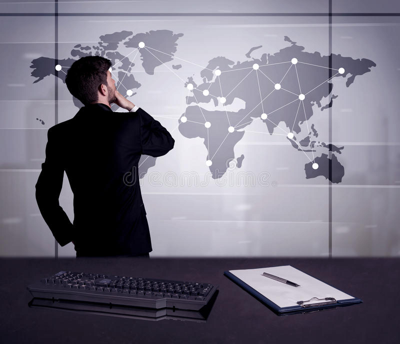 Business person drawing dots on world map. A young office worker drawing on world map and connecting dots with lines, presenting marketing sterategy at office royalty free stock photography