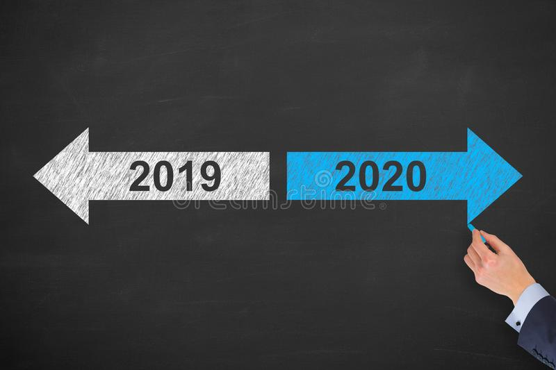 Business Person Drawing Old Year New Year 2020 on Blackboard Background stock images