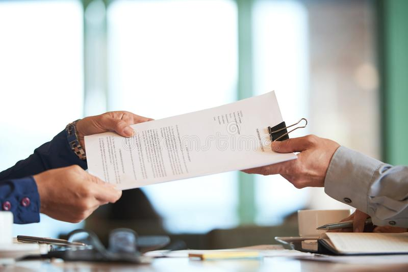 Partnership. Business person giving partnership agreement to coworker stock images