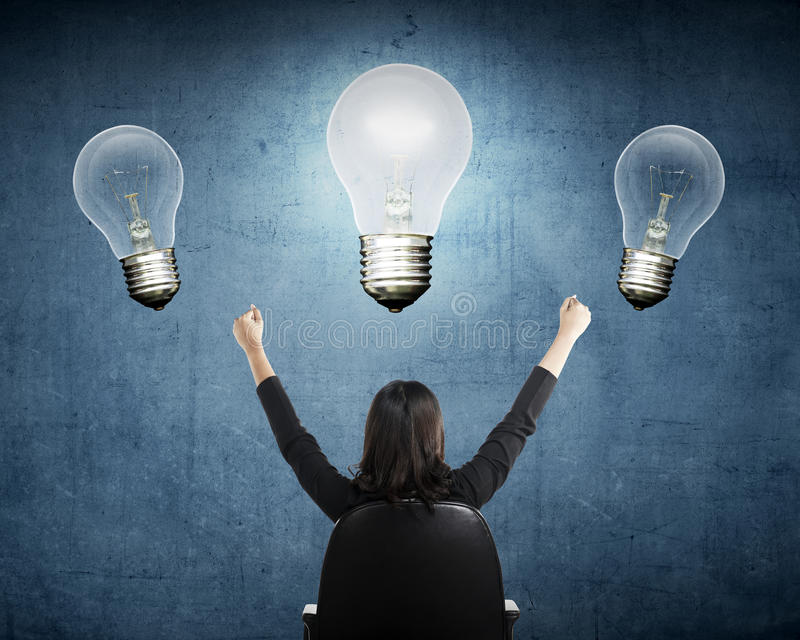 Business person have bright idea light bulb. Business person having bright idea light bulb concept over grunge background stock photos