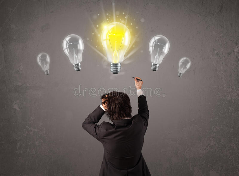 Business person having an idea light bulb concept. Business person having an bright idea light bulb concept stock photos