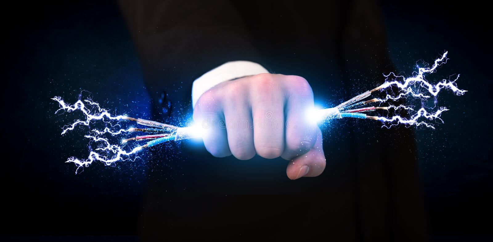 Business person holding electrical powered wires. Concept on background royalty free stock images