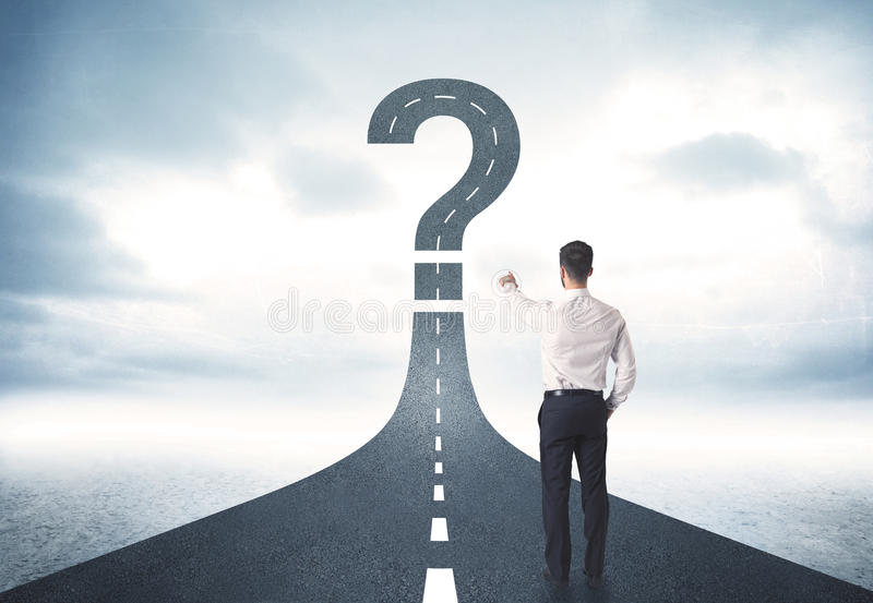 Business person lokking at road with question mark sign stock photos