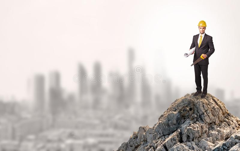Business person looking to the city from distance stock images