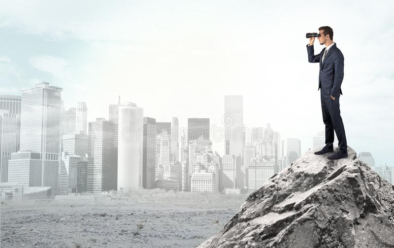 Business person looking to ruined city from distance royalty free stock photo