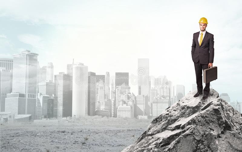 Business person looking to ruined city from distance royalty free stock photography