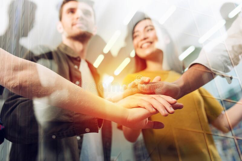 Business person put their hands together. Concept of teamwork, agreement and partnership. Double exposure stock photos