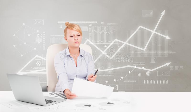 Business person sitting at desk with financial change concept. Business person sitting at desk with financial change, and report making concept royalty free stock image