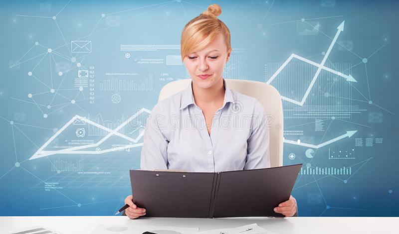 Business person sitting at desk with financial change concept. Business person sitting at desk with financial change, and report making concept stock photos