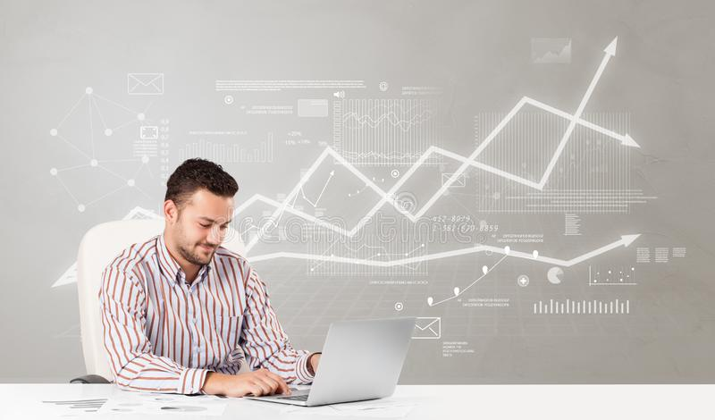 Business person sitting at desk with financial change concept. Business person sitting at desk with financial change, and report making concept royalty free stock images