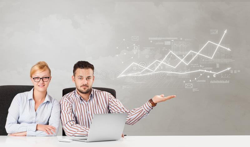 Business person sitting at desk with financial change concept. Business person sitting at desk with financial change, and report making concept stock image