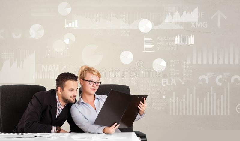 Business person sitting at desk with report analyze concept. Business person sitting at desk with financial change, and report diagram concept stock image
