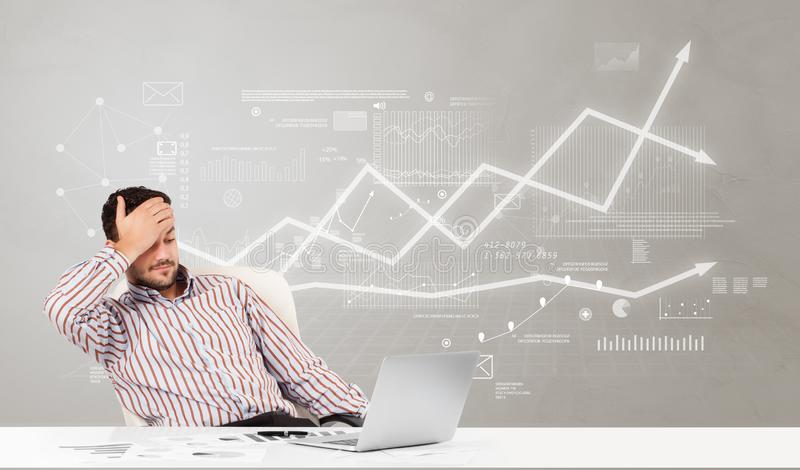 Business person sitting at desk with financial change concept. Business person sitting at desk with financial change, and report making concept stock images