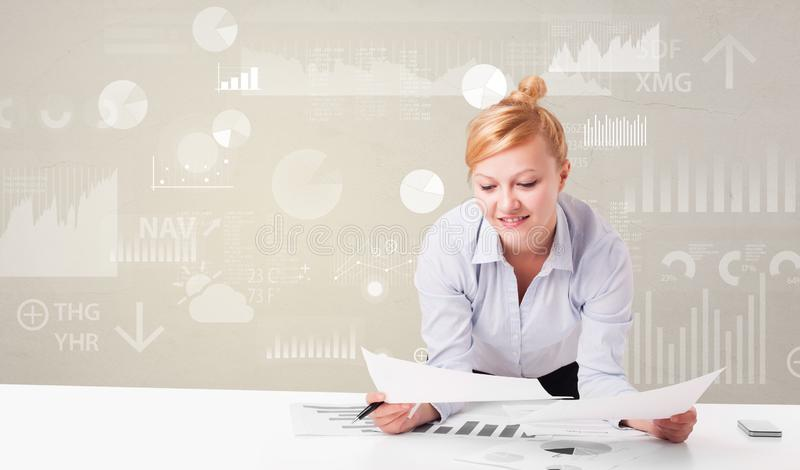 Business person sitting at desk with report analyze concept. Business person sitting at desk with financial change, and report diagram concept royalty free stock photos