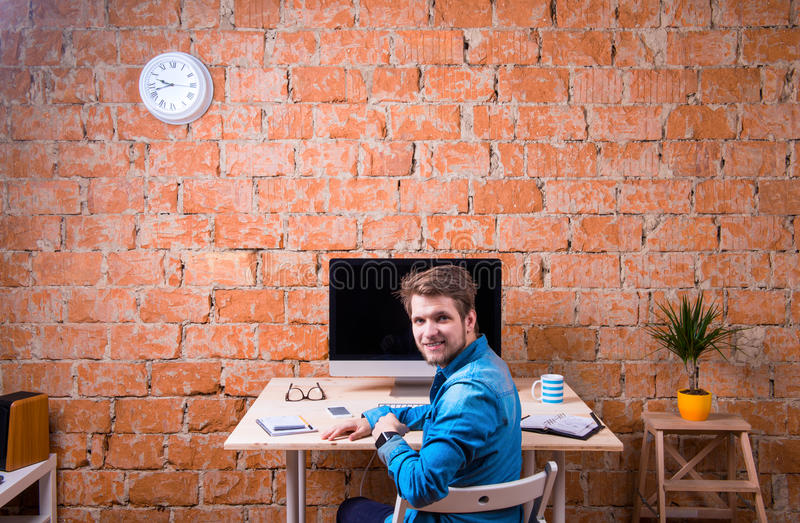 Business person sitting at office desk wearing smart watch stock photos