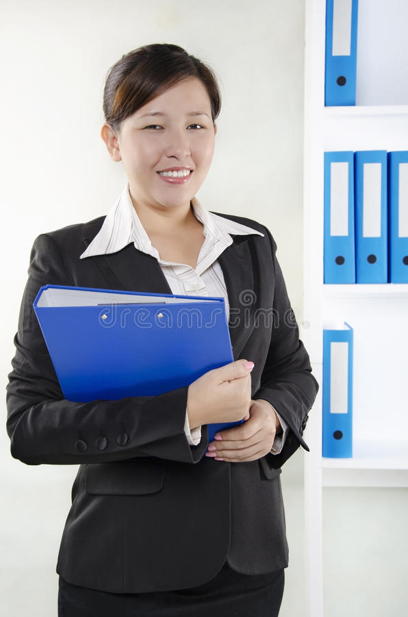 Download Business Person Standing And Holding A Document Stock Photo - Image: 25971362