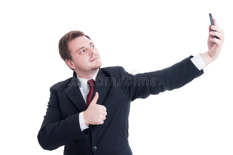 Business person taking a selfie and showing like stock photography