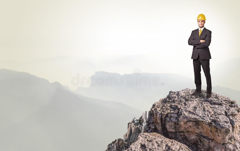 Business person on the top of the rock stock photos