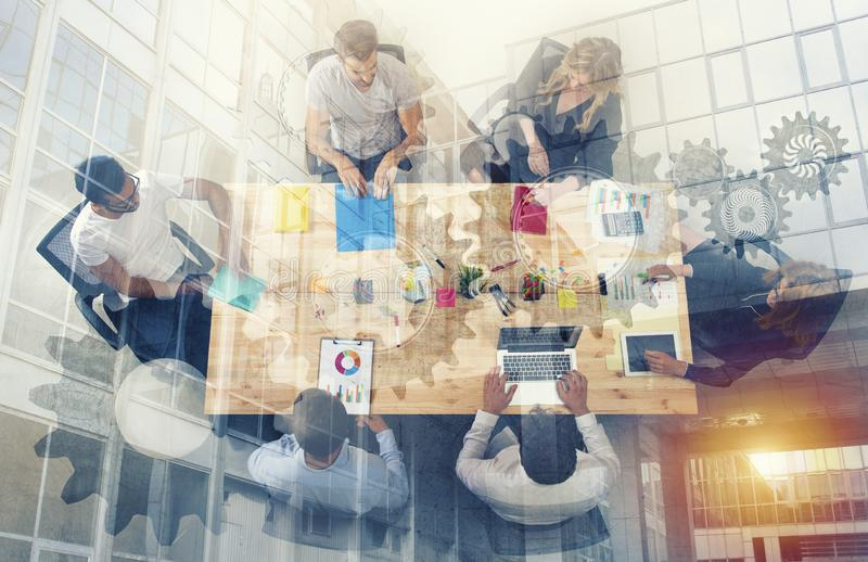 Business person work together in office. concept of teamwork, business partnership and startup. double exposure royalty free illustration